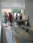 Volunteers working on carpentry on porch.