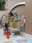 Judith Inglese installing a tile mural in Town Square