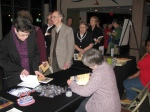 Book signing in foyer.