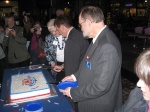 Mayor and Council cutting the cake.