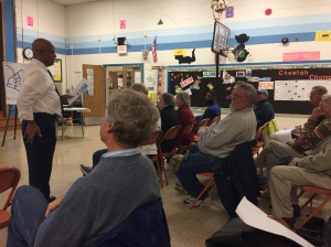 Residents listen to Tasfai Gieorgis of WSSC explain the upcoming water main replacement project in Twinbrook.